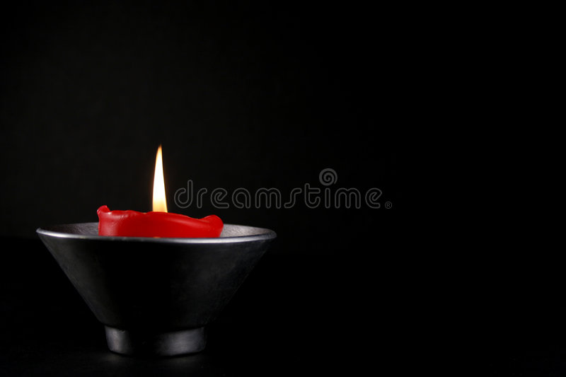 Isloated Red Candle. Burning red candle royalty free stock photo