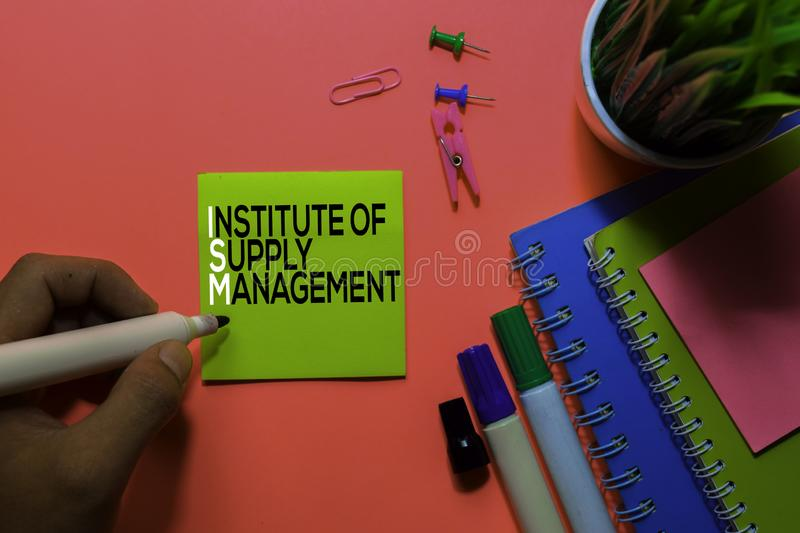 ISM. Institute of Supply Management acronym on sticky notes. Office desk background stock photo