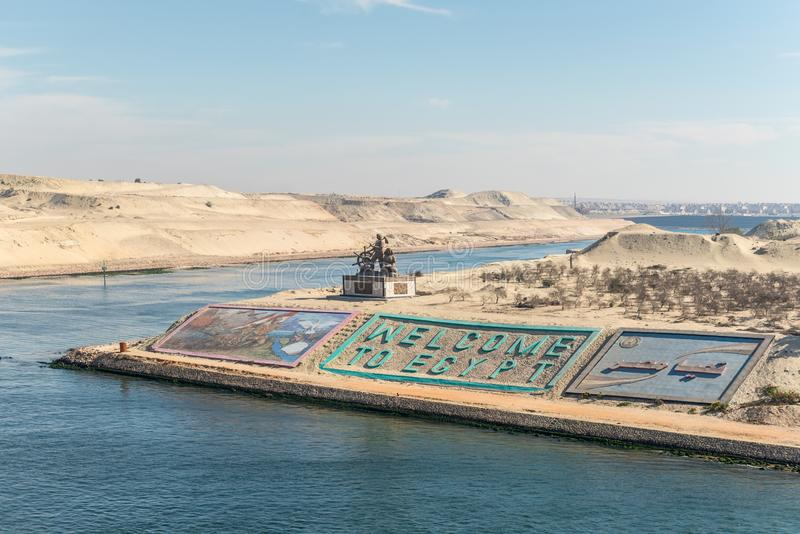 Greetings in Egypt at new Suez Canal in Ismailia, Egypt. Ismailia, Egypt - November 5, 2017: Suez canal authority monument and gigantic letters saying `welcome stock image