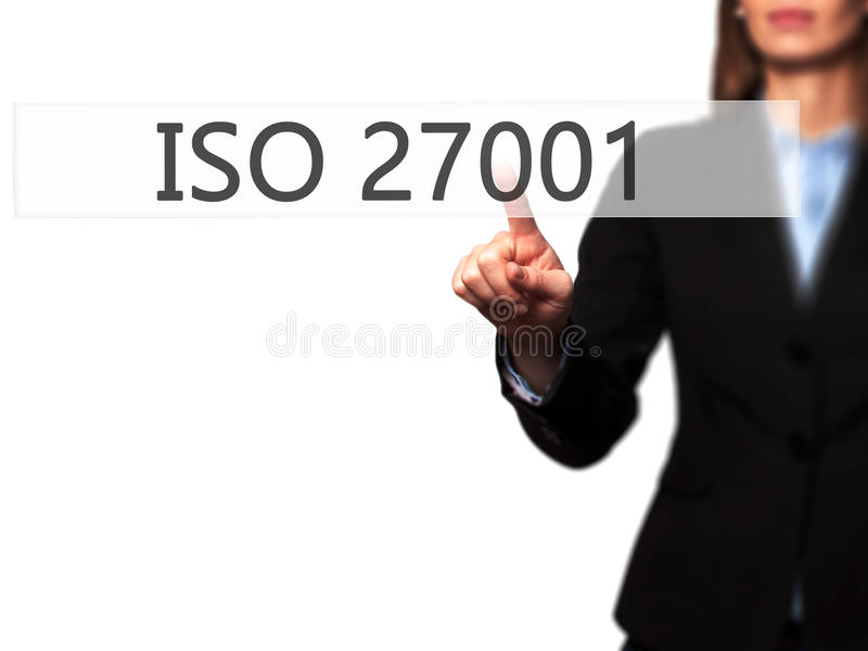 ISO 27001 - Businesswoman hand pressing button on touch screen i royalty free stock images