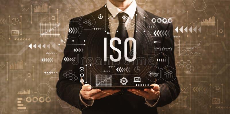 ISO com o homem de negócios que guarda um tablet pc foto de stock