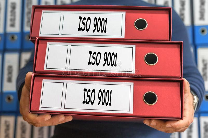 ISO 9001 concept words. Folder concept. Ring binders. Administration. stock image