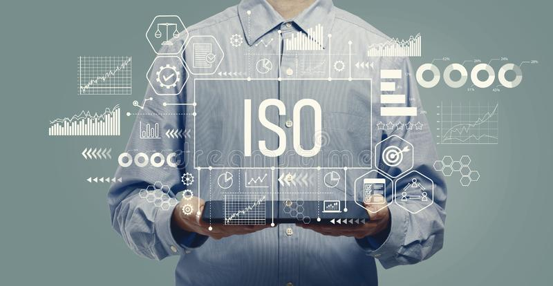ISO concept with man holding a tablet royalty free stock photography