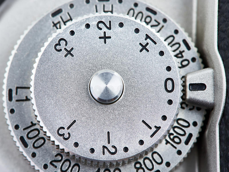 ISO and exposure compensation control dial on SLR camera. Closeup royalty free stock photo