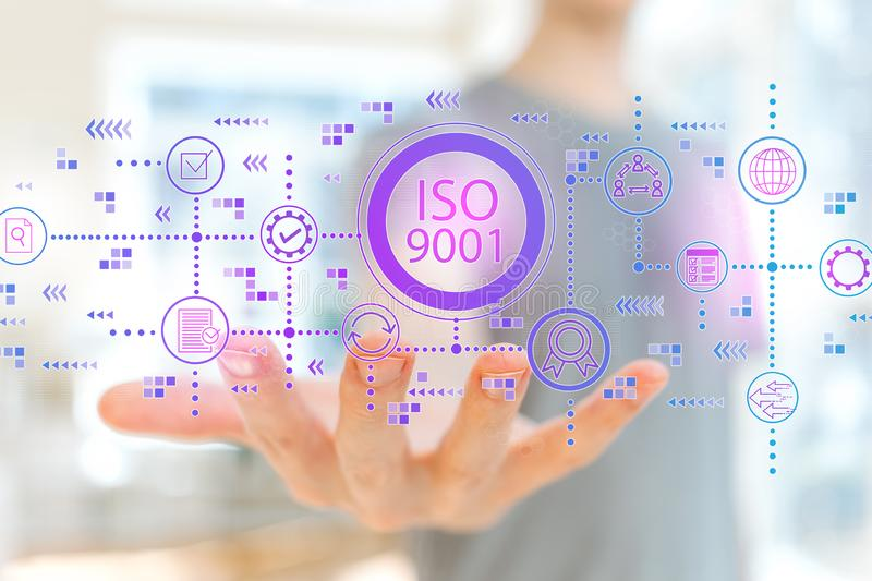 ISO 9001 med den unga mannen royaltyfri foto