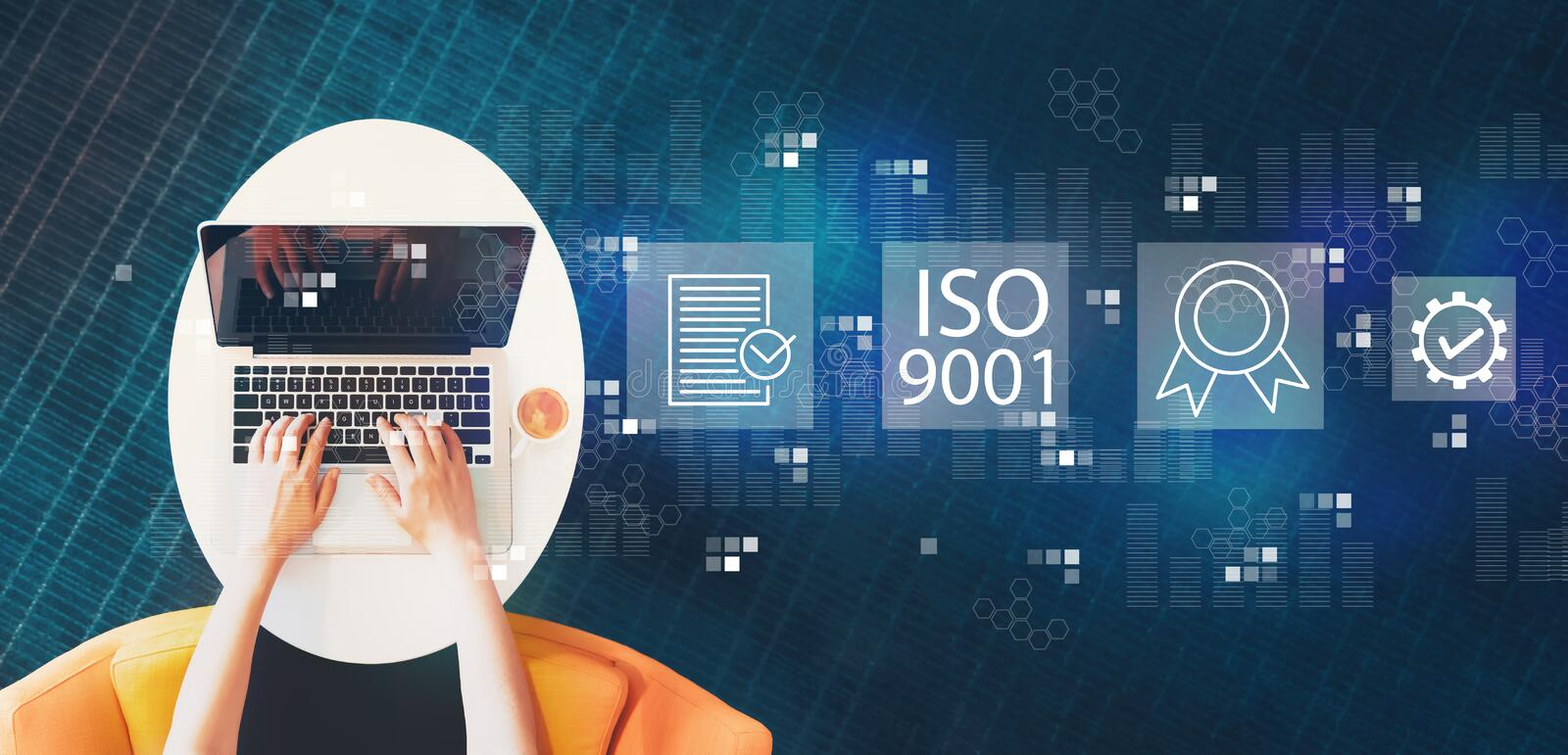 ISO 9001 with person using a laptop royalty free stock photography