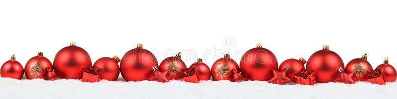 ISO roja del invierno de la nieve del fondo de la decoración de la bandera de las bolas de la Navidad fotos de archivo