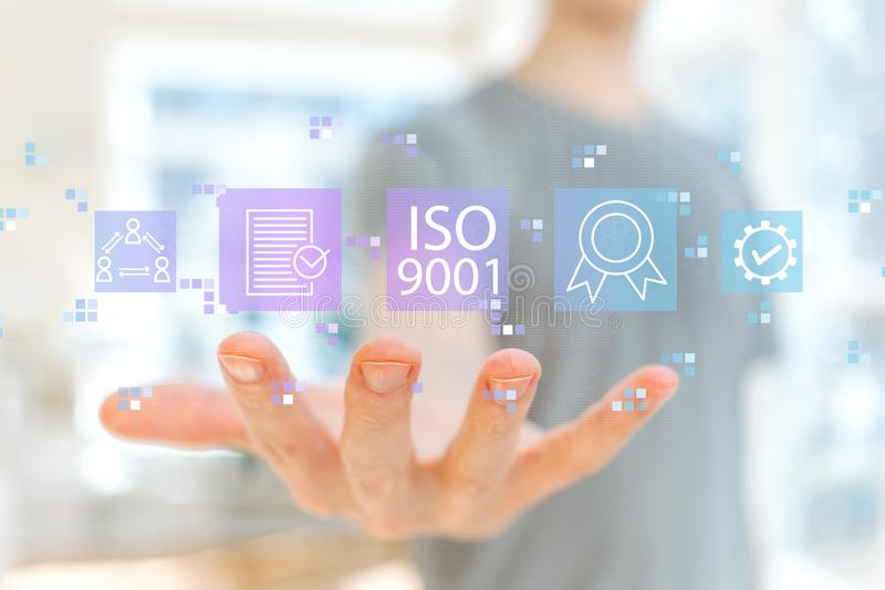 ISO 9001 with young man royalty free stock images