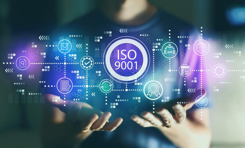 ISO 9001 with young man. In the night stock illustration