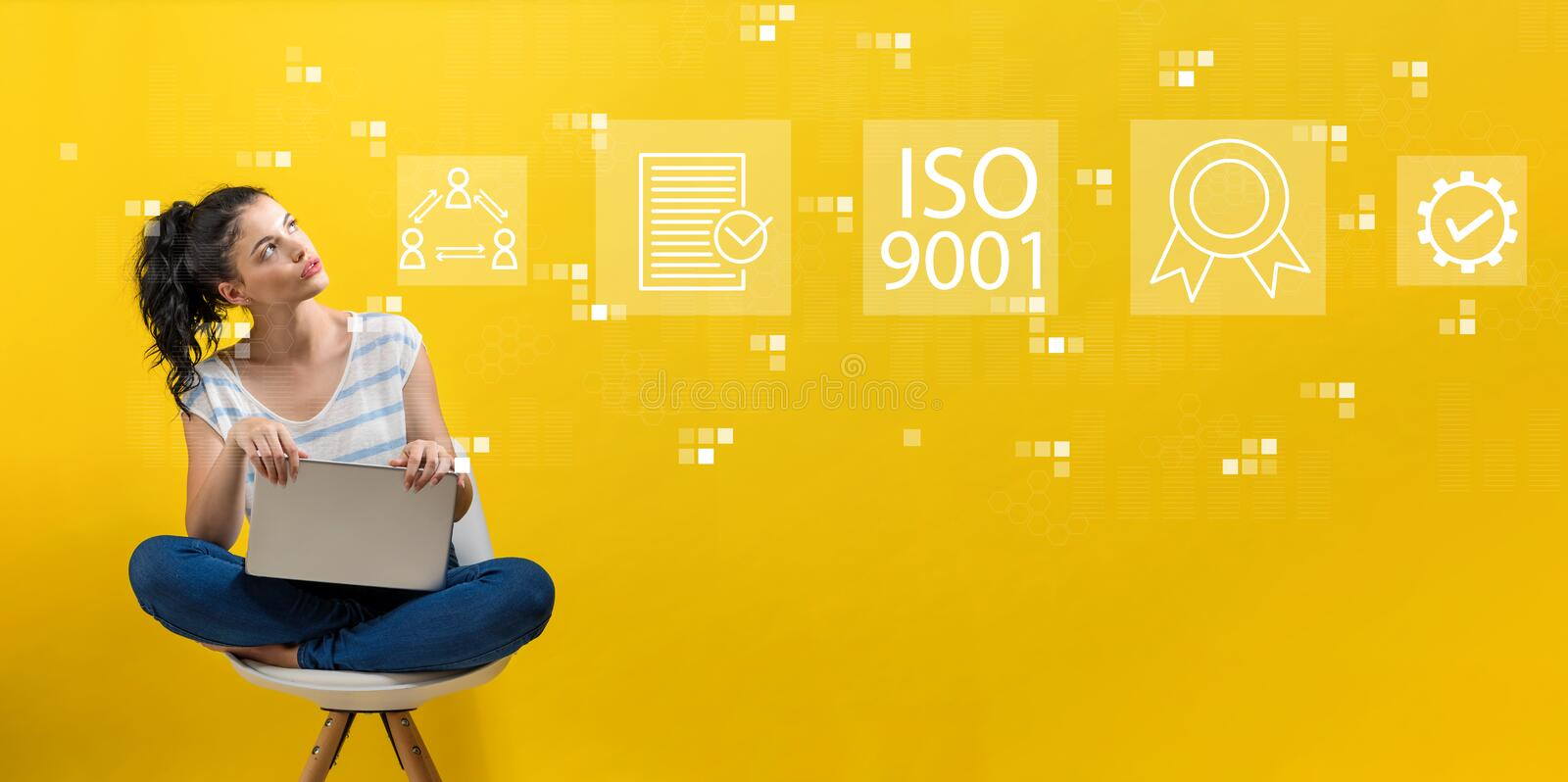 ISO 9001 with woman using a laptop stock photography