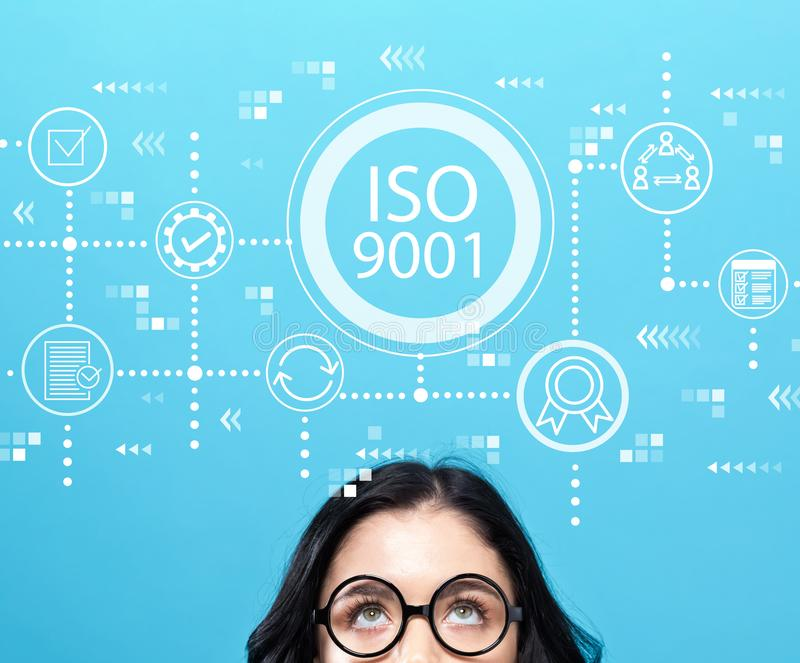 ISO 9001 with young woman stock photo