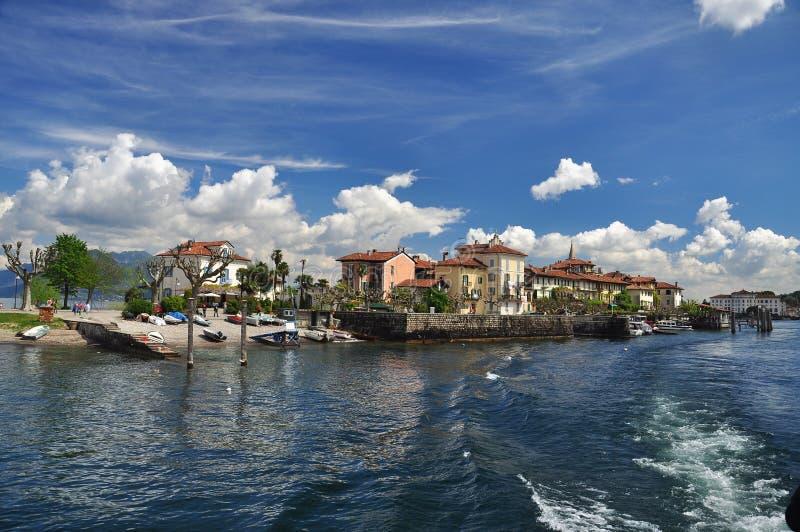 Stresa, Italy. Isola dei Pescatori, Lake Maggiore. The lake shore promenade on Isola dei pescatori island village, Lago Maggiore, Stresa, Italy. Blue Spring sky stock image
