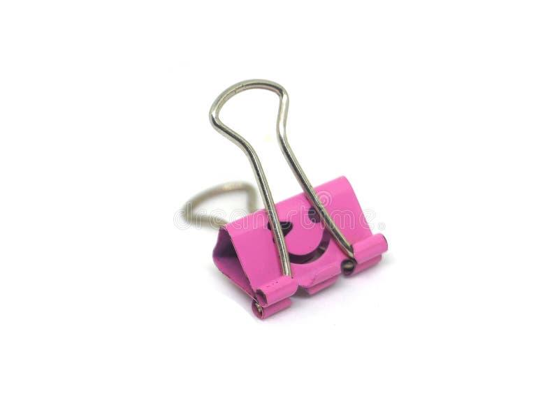 Isolado cor-de-rosa do grampo da pasta no branco fotografia de stock