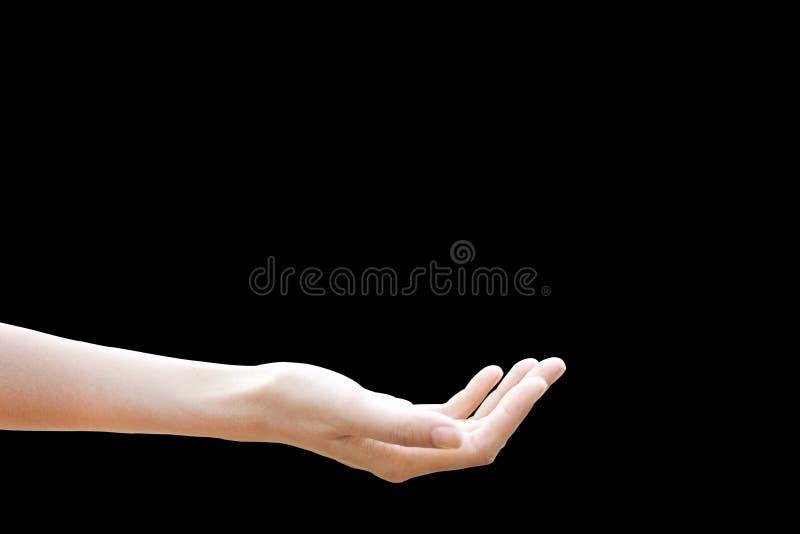 Isolado da mão da jovem mulher do apoio com em fundo preto, trajeto de grampeamento foto de stock