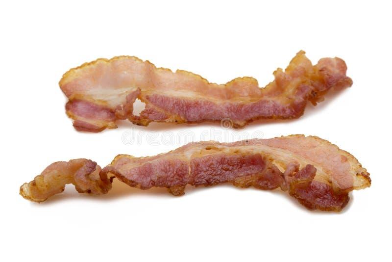 Isolado de Fried Smoked Bacon no conceito branco do fundo foto de stock royalty free
