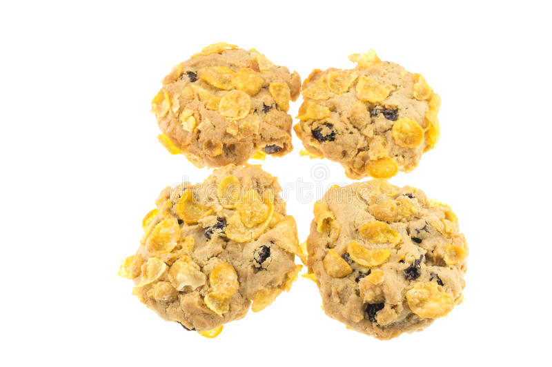 Isolado do corinto e da cookie dos flocos de milho no fundo branco fotos de stock royalty free