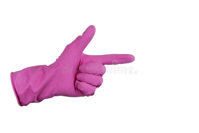 Isolado em um fundo branco Mão na luva de borracha Rosa do ` s da luva O dedo mostra o sentido imagens de stock