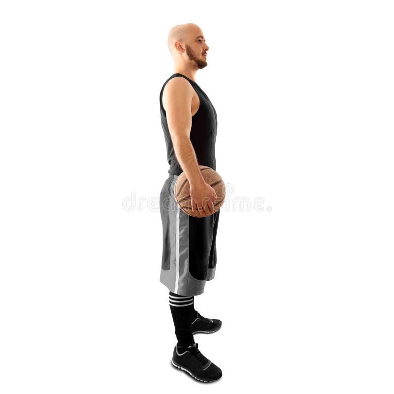 Isolado no jogador de basquetebol branco do fundo com bola fotografia de stock