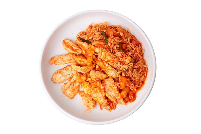 Fried kimji with skinless chicken in korean white plate. Isolared of fried kimji with skinless chicken in korean white plate served on wood stock images