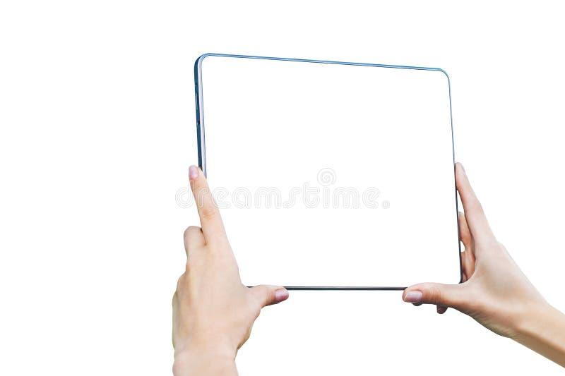 Isolatåtlöje upp minnestavlan i kvinnliga händer - Closeup, på en vit bakgrund arkivfoton