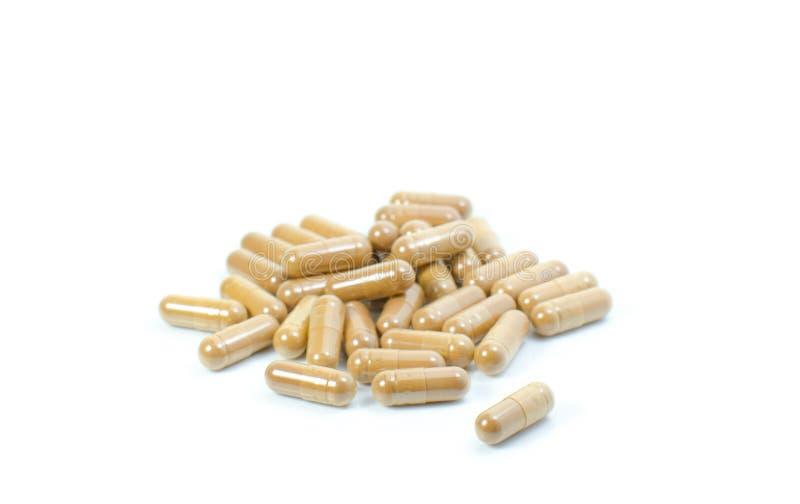 Isolat de fines herbes de capsule de drogue sur le fond blanc photographie stock