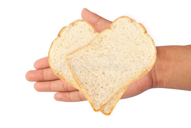 isolat de pain blanc en main sur le fond blanc photographie stock