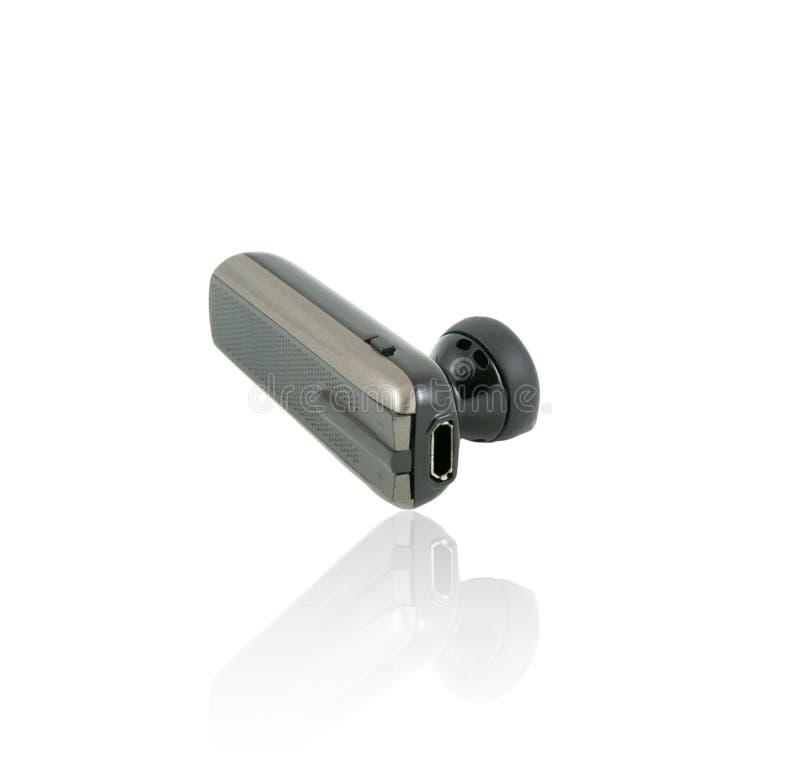 Isolat handless d'écouteur de téléphone portable de Bluetooth photographie stock libre de droits
