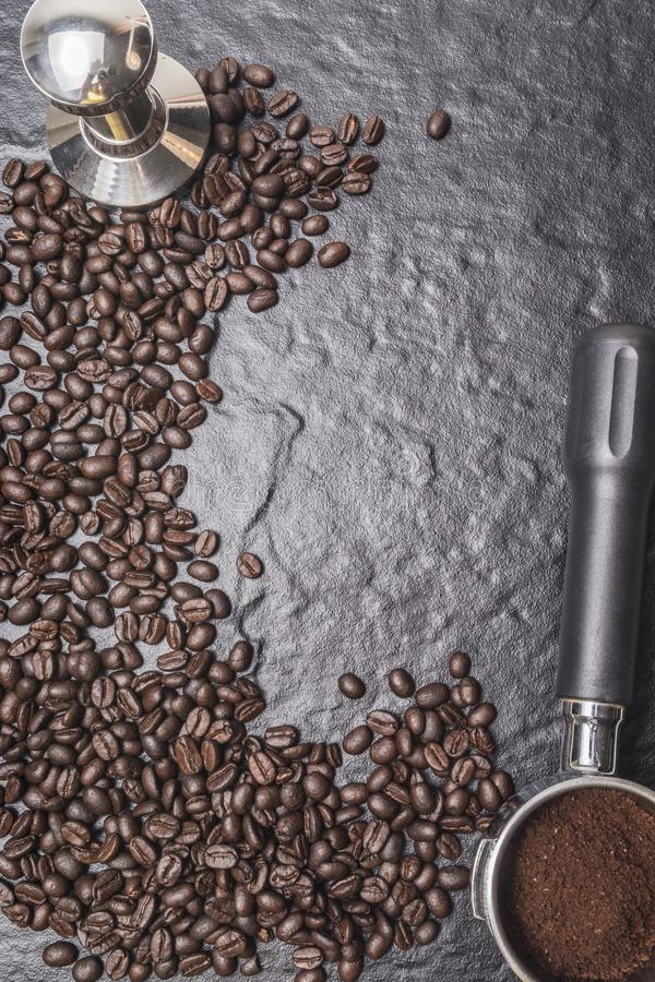 coffee bean and tamper on rock for menu stock images