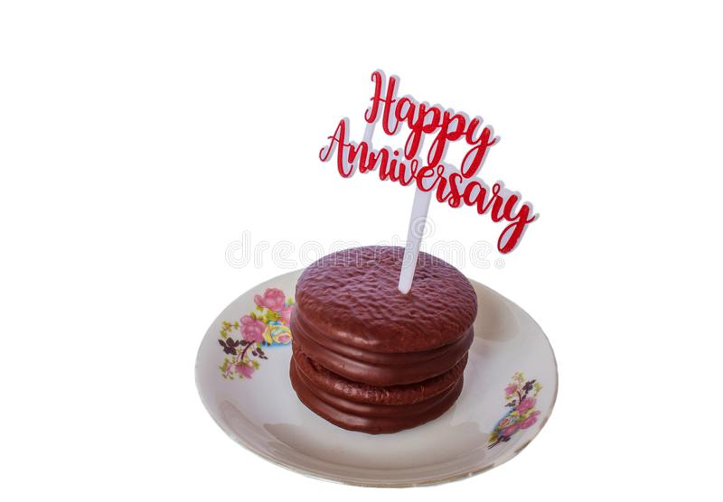 Isolate of Happy Anniversary Cake. Isolate of Soft Chocolate Cookies on White Ceramic Plate With Happy Anniversary Letter stock photos