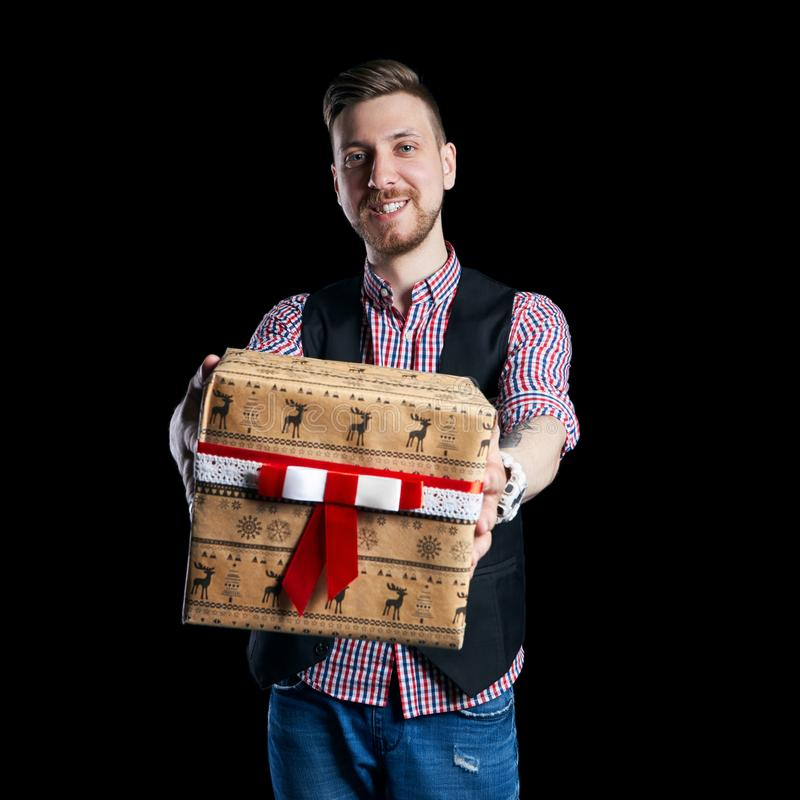 Isolate Man holding a box of Christmas gifts in his hands on sale. The father gives family gifts. Christmas sale, discounts stock photos