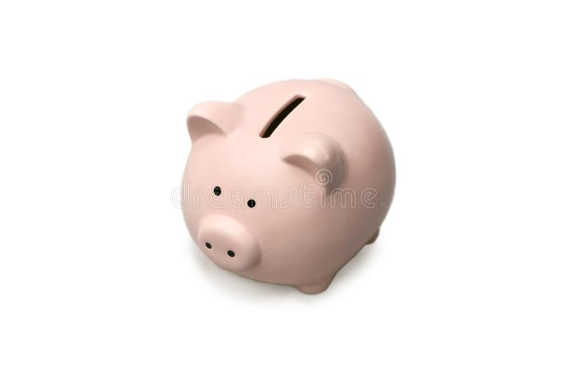 Isolate. The pink piggy Bank stands on an isolated white background with a shadow. royalty free stock images
