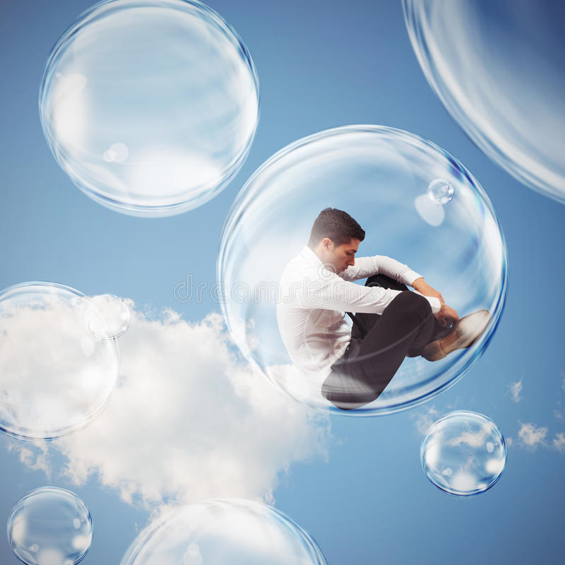 Isolate themselves inside a bubble. Sad businessman flies in a bubble. isolate themselves inside a bubble detachment from the outside world concept royalty free stock photos