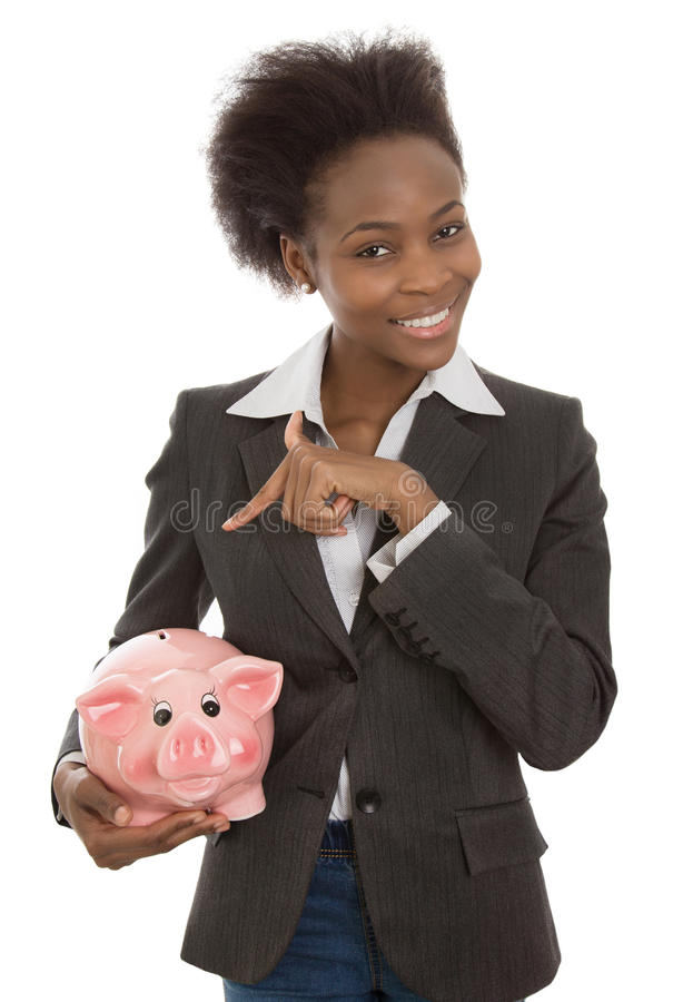 Isolated afro american businesswoman with piggy bank: money concept. royalty free stock photo
