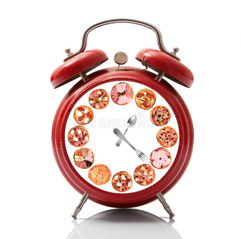 Alarm clock with pizza dial on white background royalty free stock photography