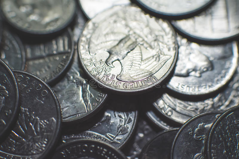 Isolated american coins background. A lot of american dollars and cents. Dollar coins background. Monetary. Business and finance equipment stock images