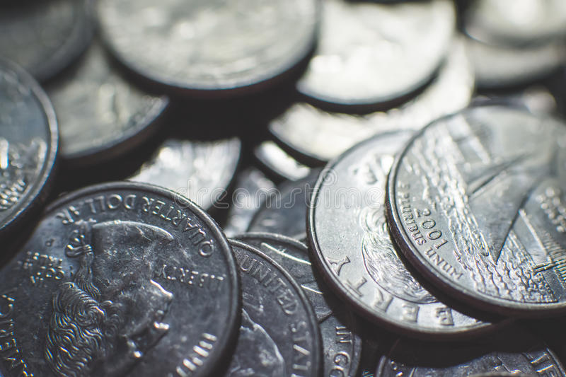 Isolated american coins background. A lot of american dollars and cents. Dollar coins background. Monetary. Business and finance equipment stock photography