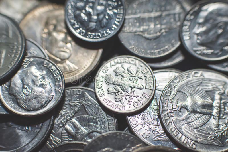 Isolated american coins background. A lot of american dollars and cents. Dollar coins background. Monetary. Business and finance equipment royalty free stock images