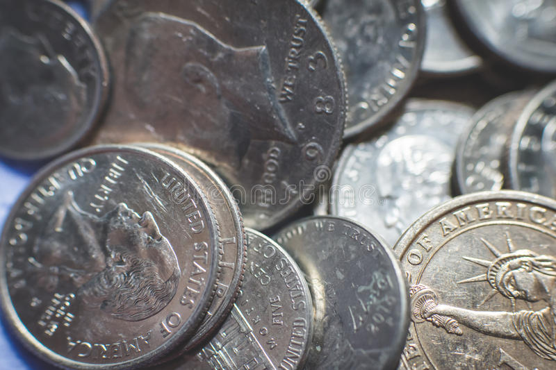 Isolated american coins background. A lot of american dollars and cents. Dollar coins background. Monetary. Business and finance equipment royalty free stock photo