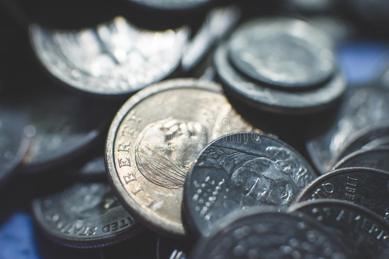 Isolated american coins background. A lot of american dollars and cents. Dollar coins background. Monetary. Business and finance equipment stock image
