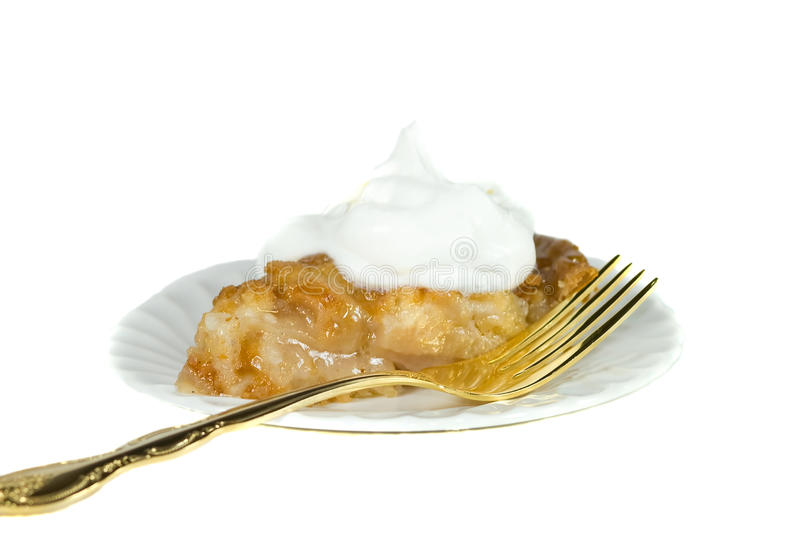Isolated apple pie slice with golden fork. stock photos
