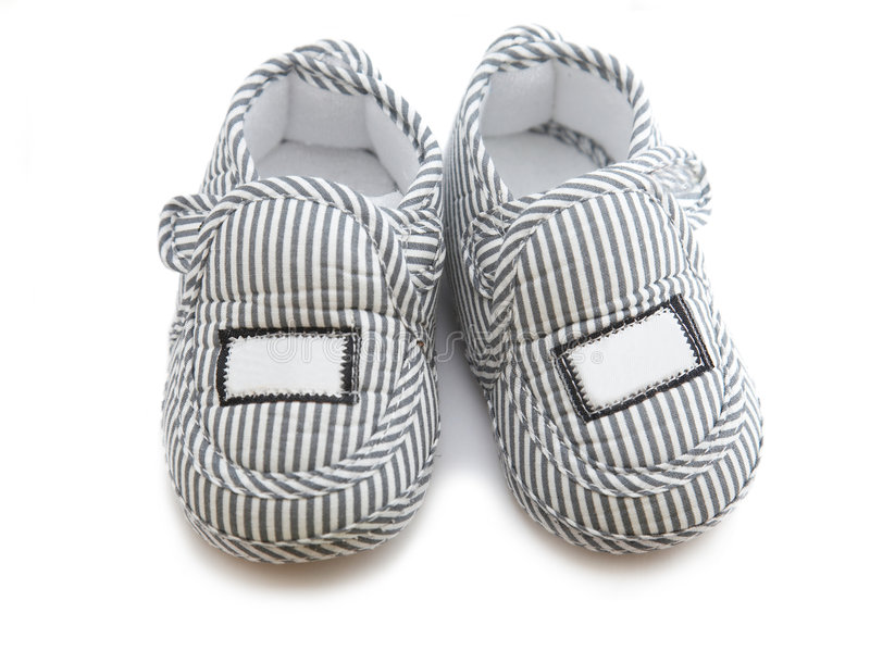 Isolated baby shoes royalty free stock photography