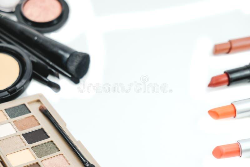 Isolated background cosmetic object, powder, lipstick, eyelash o royalty free stock photo