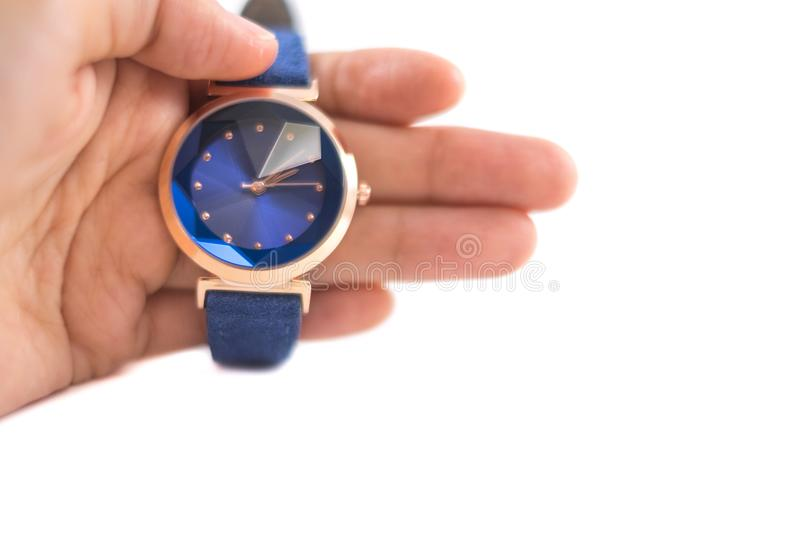 Isolated background hand of caucasian woman hold watch with copy. Isolated background hand of caucasian woman hold blue watch with copy space. image for business royalty free stock photos