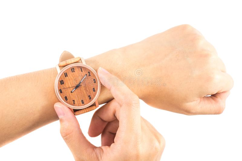 Isolated background hand of caucasian woman wearing wooden watch. With copy space. image for business, retro, accessory, time, vintage, classic, style, body royalty free stock image