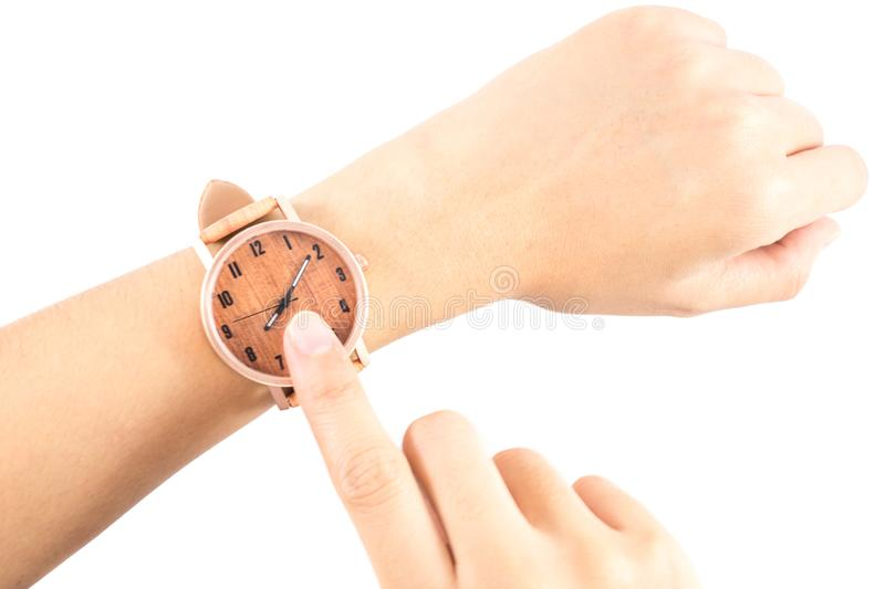 Isolated background hand of caucasian woman wearing wooden watch. With copy space. image for business, retro, accessory, time, vintage, classic, style, body royalty free stock images
