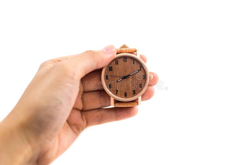 Isolated background hand of caucasian woman wearing wooden watch. With copy space. image for business, retro, accessory, time, body, antique, fashion concept royalty free stock images
