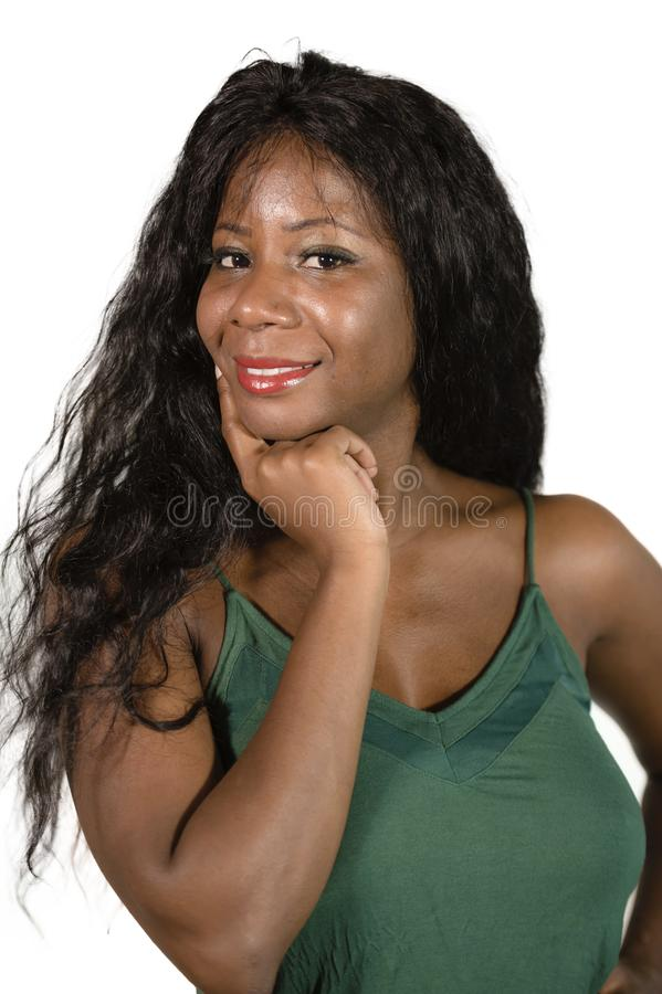Isolated background portrait of young happy and excited black African American woman with amazing beautiful long hair posing caref stock image