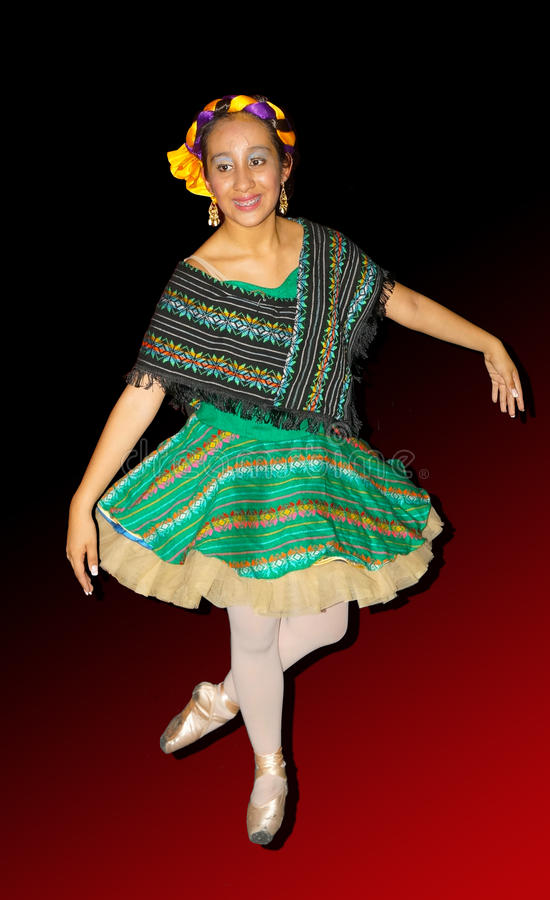 Isolated ballerina. Young girl dancer, ballerina isolated wearing a traditional costume of mexico, green skirt and a big black and mint green zarape as a