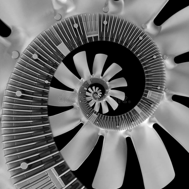 Isolated on black abstract spiral fractal made of truck diesel engine fan silver air screw. Spiral background pattern engine fan. royalty free illustration