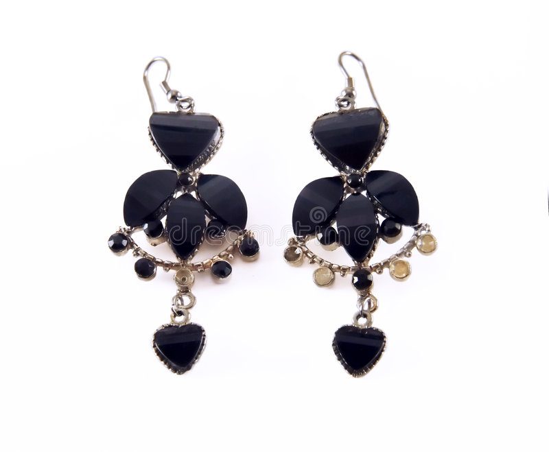 Isolated black earrings stock photography